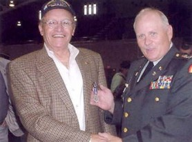 "Jim Bordino, Senior Technical Consultant to Papp Iron Works received NJ's highest military award, the ""Distinguished Service Medal"". Pictured is Brigadier General Glen K Rieth awarding the medal to Jim Bordino. The award presentation was held May 30, 2002 at the Teaneck National Guards Armory."